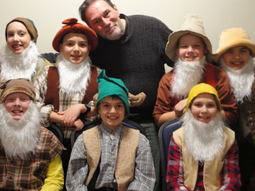 Towngate volunteer Bob Gaudio with the dwarfs in Snow White.