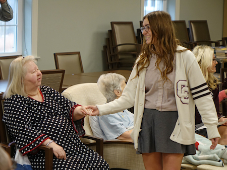 Wheeling Catholic Central students study with Alzheimer's Poetry Project founder Gary Glazner and visit with residents at Wheeling Hospital's Continuous Care Center.