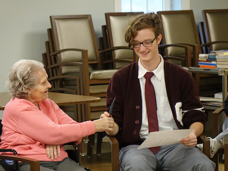 Wheeling Catholic Central students study with Alzheimer's Poetry Project founder Gary Glazner.