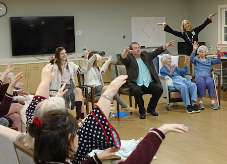 Wheeling Catholic Central students and Alzheimer's Poetry Project founder Gary Glazner work with residents at Wheeling Hospital's Continuous Care Center.